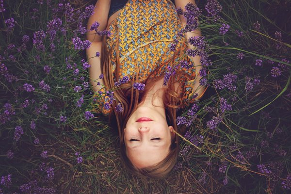 smiling girl laying on flowers