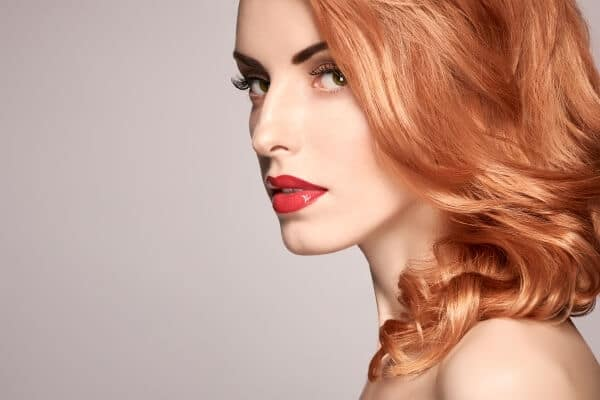 Redhead woman with striking look and eyelashes