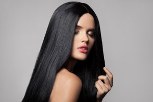 Beautiful woman with long black shiny hair