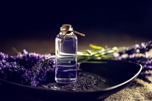 Lavender oil and a few lavender flowers