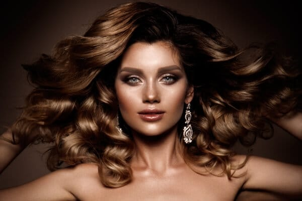 Glamorous woman with thick golden brown hair