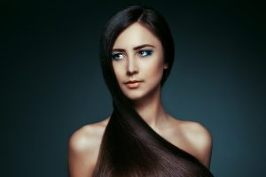 Beautiful woman with long and healthy brown hair