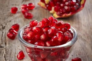 Seeds of pomegranate fruit on glass bowl