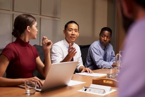 Team of experts meeting in a conference room